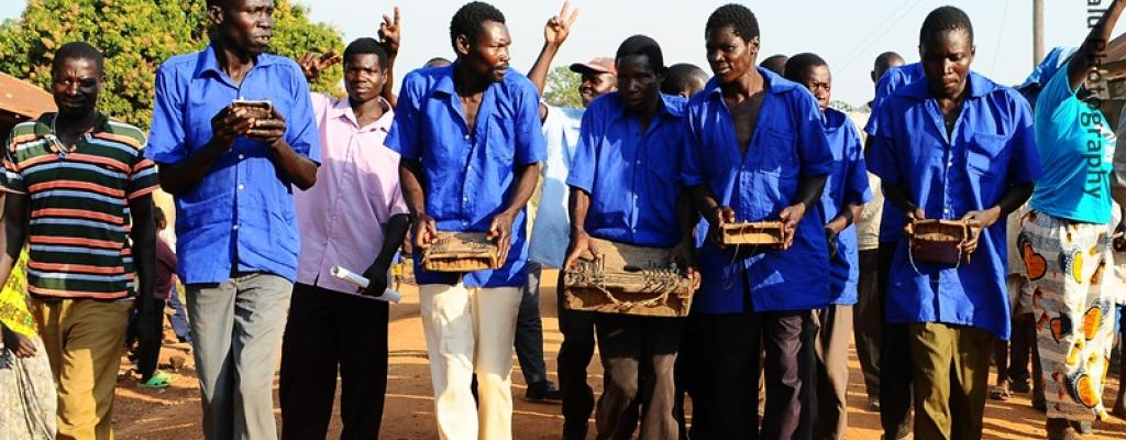"Men play ""Akongo"", a traditional music instrument for the Teso people in Serere"